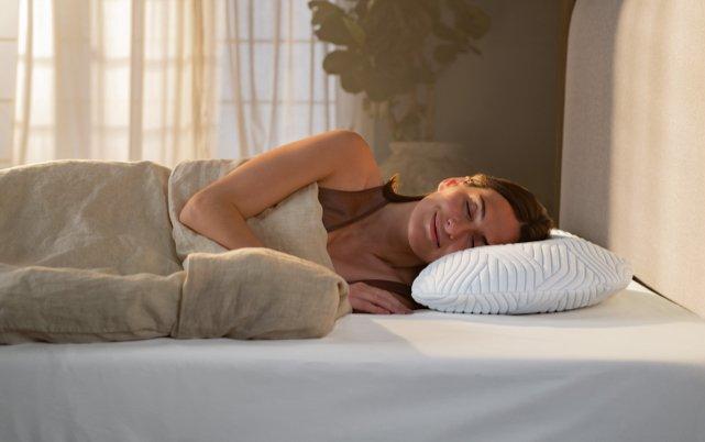Woman laying on TEMPUR Pillow